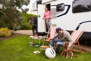 RV couple with dog