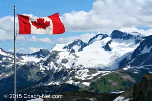 Canadian-flag-over-mountains