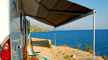 RV awning by beach